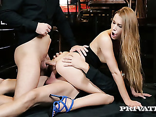 Lovely and young blonde babe at a catch bar blows two big dicks