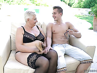 Grown-up short haired kirmess nympho in black stockings is fucked doggy hard