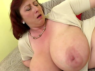 Mature big gun mom involving big tits with an increment of hungry cunt